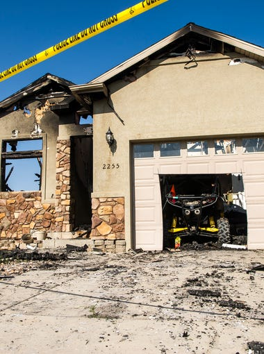 A Cedar City house that caught fire Aug. 12, 2018, is cordoned off. Officials found a man's body in the structure after putting out the blaze.