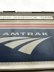 An Amtrak train from Chicago to Grand Rapids, Michigan, hit an unoccupied vehicle on the track in Indiana, but no passengers or crew were injured.