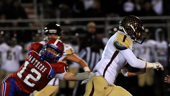 Licking Valley's Ethan Brechbill lunges after Licking Heights' Nate Thacker as he goes on a 51-yard punt return for a score in the first quarter on Friday, Oct. 30, 2015 at Valley. The Hornets defeated the Panthers 35-7.