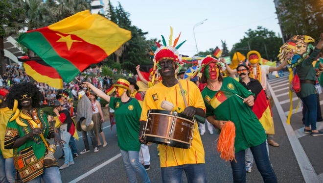 People in blackface wearing African clothing and carrying bananas marched in a government-backed weekend parade in Sochi, a city that will host one of Cameroon's matches at the Confederations Cup.