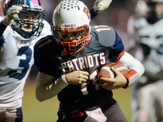 Red Land quarterback Garrett Scott rushes for a touchdown against Conrad Weiser in the second half of a District 3 Class AAA quarterfinal football game on Friday, Nov. 14, 2014, at West Shore Stadium. Red Land defeated Conrad Weiser 42-21 to advance to the semifinal game. Chris Dunn Ñ Daily Record/Sunday News