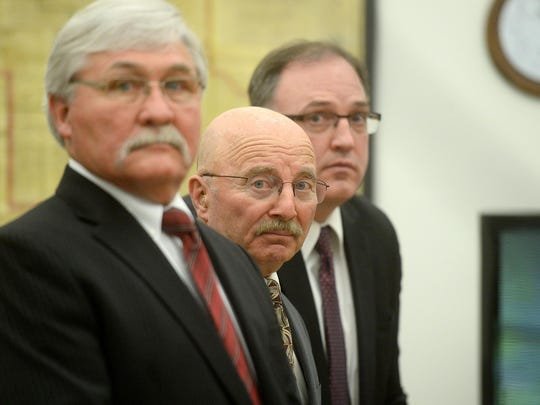 Joseph Campbell is flanked by his counsel, Greg Jackson, left, and Chad Wright, just before District Court Judge DeeAnn Cooney makes her ruling on Campbell's change of plea on May 18, 2016.