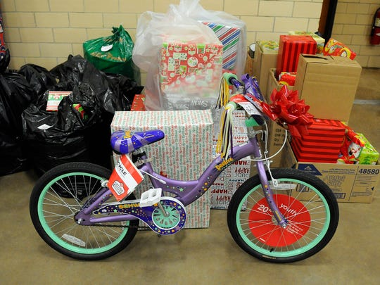 A child's bicycle is among gifts prepared by Catholic
