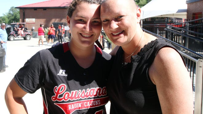 UL outfield Shellie Landry and her mother, Debbie, pose for a photo following UL's 9-3 victory over UL-Monroe in an NCAA softball game Sunday, May 4, 2014, at Lamson Park in Lafayette, La.