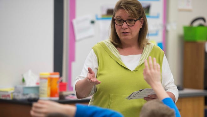 Lisa Brandenstein leads a vocabulary lesson in her fifth grade class at North Elementary School in Poseyville on Tuesday, March 20, 2018. Brandenstein has been a teacher for 28 years.