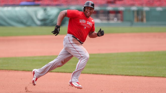 Red Sox third baseman Rafael Devers runs to third base during a recent Summer Camp practice at Fenway Park. Manager Ron Roenicke has said that he would like to see Devers hit second in the lineup this season.