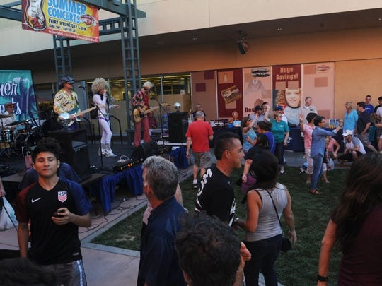 People dance at the Janss Marketplace free concert in August 2016.
