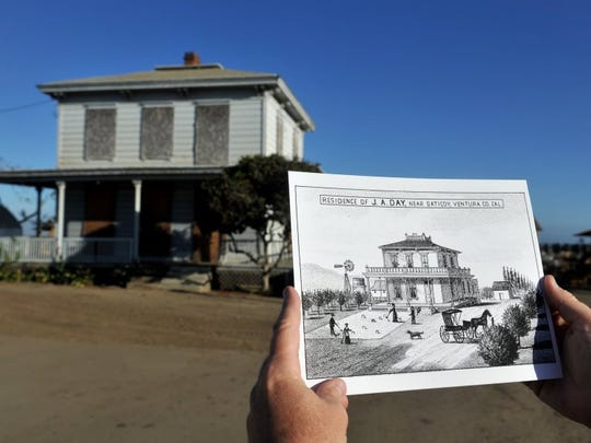 JOSEPH A. GARCIA/THE STAR Stephen Schafer, a board member with the San Buenaventura Conservancy, a nonprofit focused on historical preservation, displays a drawing of the James Day residence, from 1883, with the house, in background, in its present condition.