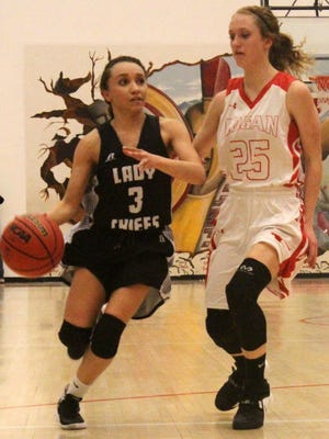 Janessa Melendrez, left, sprints toward the basket while being guarded by McKenna Stone.