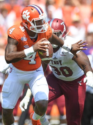 Clemson quarterback Deshaun Watson (4) carries against Troy during the 1st quarter on Saturday, September 10, 2016 at Clemson's Memorial Stadium.