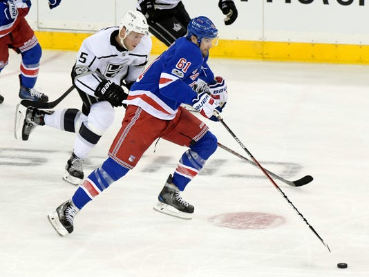 New York Rangers right wing Rick Nash (61) breaks away from Los Angeles Kings defenseman Christian Folin (5) during the third period of an NHL hockey game Friday, Dec. 15, 2017, at Madison Square Garden in New York. (AP Photo/Bill Kostroun)