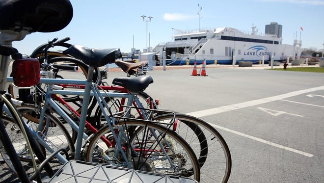 Some 700 bikes are seen lined up on the Lake Express Ferry dock at in Milwaukee on Monday, April 27, 2015. The bikes were donated to Lake Express Ferry in exchange for a complimentary round-trip ticket on Lake Express' high-speed ferry, destined for Muskegon, Mich.