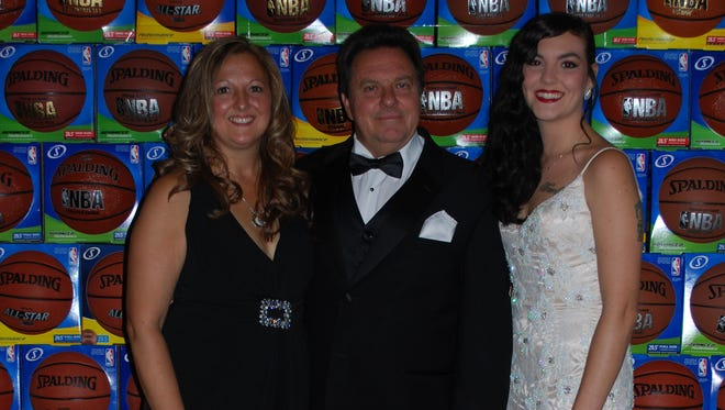 Founders of the Michael-Gene Kids Basketball Foundation are seen during the 2014 gala: Dawn Futch, Mike Futch and Stephanie Futch.