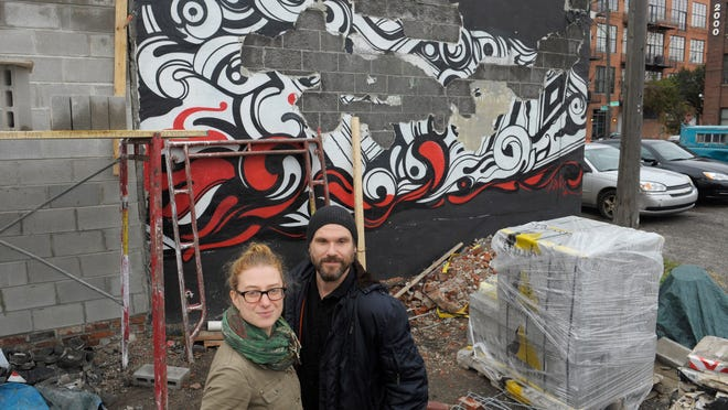 A mural at Brooklyn Street Local, commissioned by owners Deveri Gifford and Jason Yates, is being repaired. Mayor Mike Duggan visited the diner Wednesday to apologize for the ticket they received.