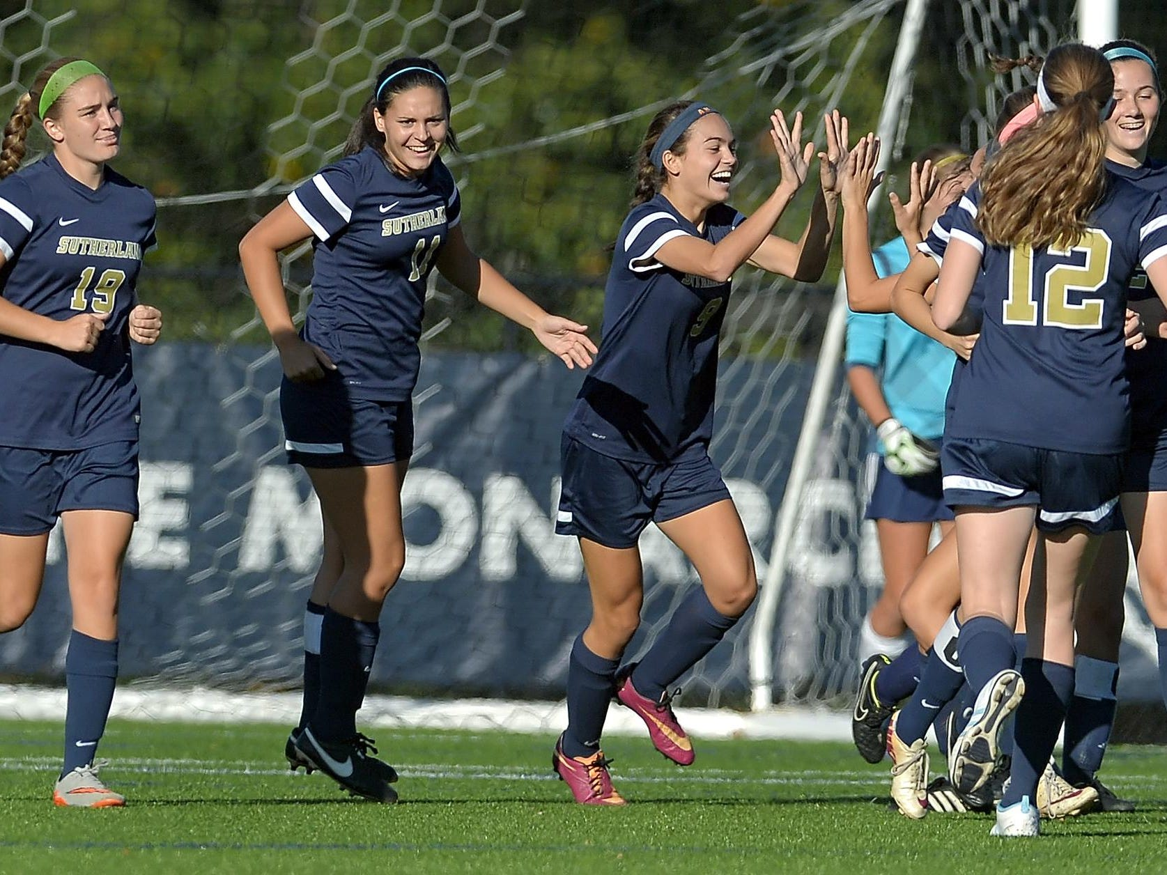 Pittsford Sutherland players celebrate their first goal.
