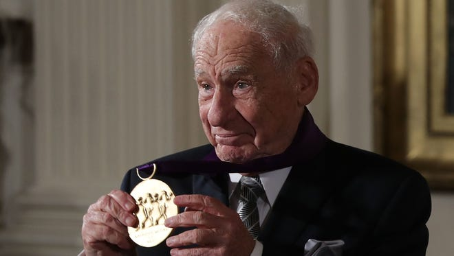Comedian Mel Brooks is presented with the National Medal of Arts during an East Room ceremony at the White House Thursday. President Obama awarded the 2015 National Medal of Arts and the National Humanities Medal to recipients in the annual ceremony.
