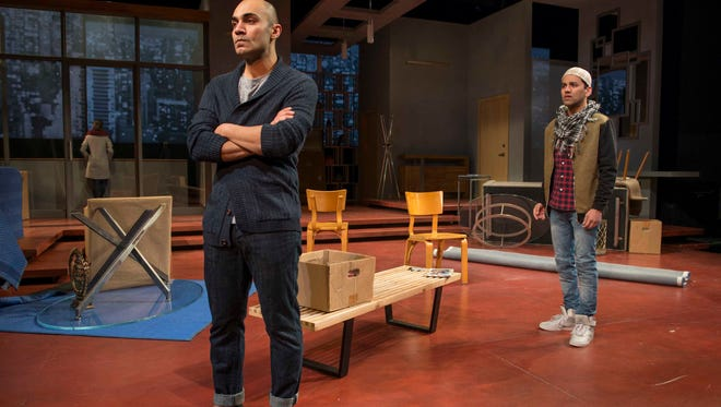 """Maboud Ebrahimzadeh (left) and Imran Sheikh don't see eye to eye in Milwaukee Repertory Theater's production of Ayad Akhtar's """"Disgraced."""""""