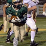 Howell's Thomas Lassitter carries the ball against Milford in a game the Highlanders won, 31-14, on Friday night.