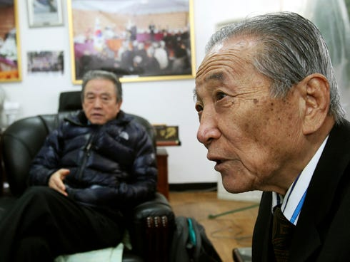 Park Boo Seo, right, a former member of the Kuwol partisan unit, speaks about Merrill Newman.