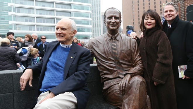 Former Indianapolis Mayor Bill Hudnut tries out a seat next to a sculpture of his likeness at Hudnut Commons at Maryland and Capitol Ave. Sunday, December 14, 2014. Joining Hudnut are artists Ana Koh and Jeff Varilla who created the statue.