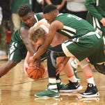 PHOTOS - Novi ousts Northville High in district playoff basketball
