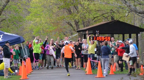 Robert Veeder sprints to the finish, completing his last lap just at the 12-hour mark of Mind the Ducks 12-hour race on May 10.