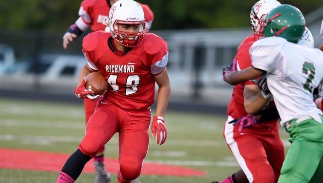 Richmond's Gavin Farrar runs the ball against Anderson Friday, Oct. 7, 2016, during a football game on Lyboult Field at Richmond High School.