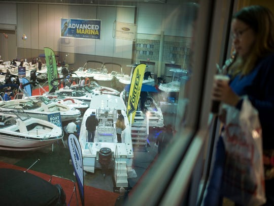 Visitors find a high vantage overlooking the main showroom at the annual Seaside Boat Show  in Ocean City. The show returns to the convention center Feb. 14-16.