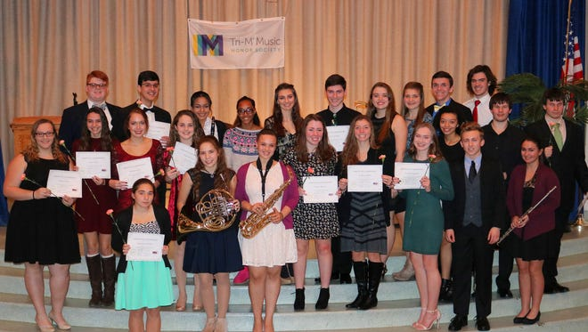 Members, including newly inducted members, of Millville High School's Tri-M National Music Honor Society are pictured at the chapter's induction ceremony, which was held on Dec. 20.