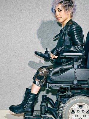 This undated image provided by Nordstrom shows a model in a wheelchair advertising boots in the company's annual July anniversary catalog, which is its biggest sale event of the year with preview discounts on new fashions for fall. Nordstrom has been using professional models with disabilities in ads and catalogs since 1997.