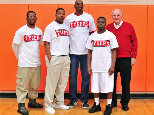 Keon Johnson (second from right) poses with four other members of the Mansfield Senior 1,000-point club in this 2013 photo: (left to right) Ahmed Kent, Marquis Sykes, Dapreis Owens and Ken McCally.