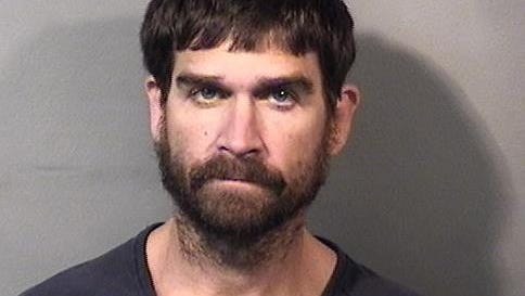 Shane Michael Cooper, 36, was charged with armed robbery, principle in the first