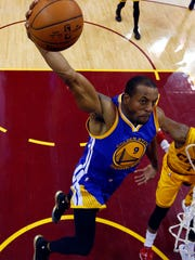 Golden State Warriors guard Andre Iguodala (9) dunks the ball against the Cleveland Cavaliers in game four of the NBA Finals at Quicken Loans Arena.