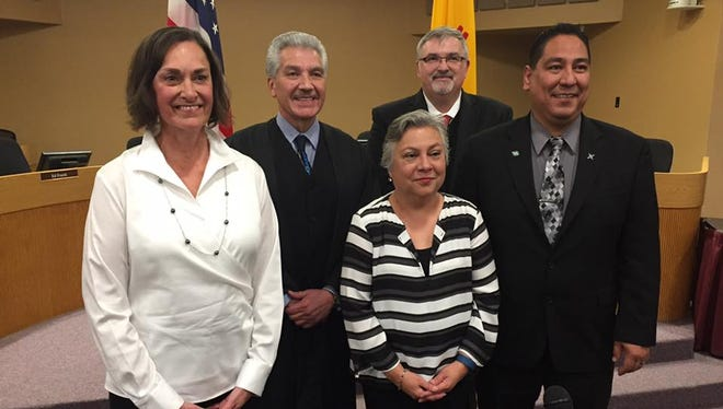 (L-R) Terrie Dallman, District Judge Fernando Macias, Maria Flores, Superintendent Greg Ewing and Ray Jaramillo pose for a photograph at the March 1 swearing-in ceremony for the Las Cruces school board.