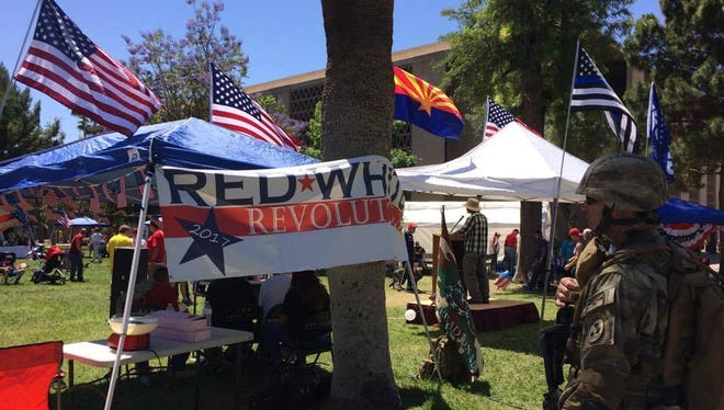 The United Liberty Coalition holds a rally to preach unity outside the Arizona Capitol building on April 22, 2017.