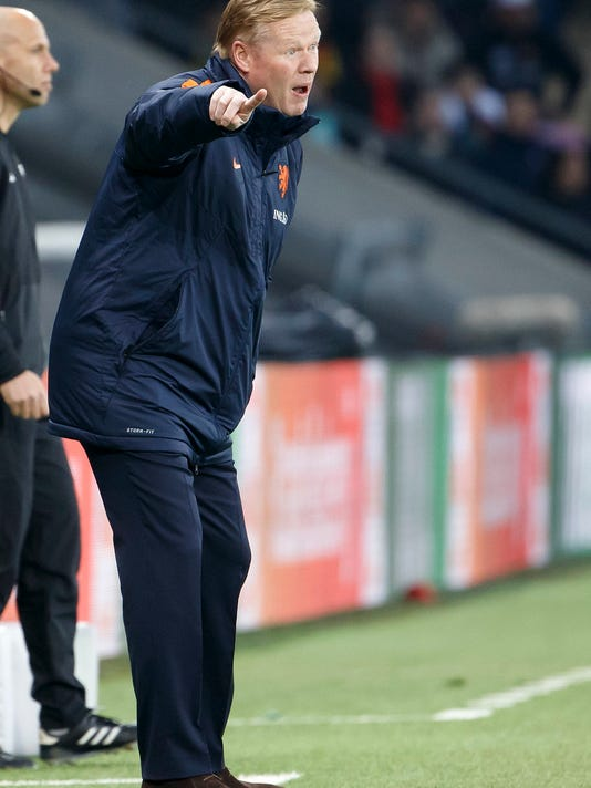 Netherlands' head coach Ronald Koeman instructs his players against Portugal during an international friendly soccer match between the national soccer teams of Portugal and The Netherlands, at the Stade de Geneve stadium in Geneva, Switzerland, Monday, March 26, 2018. (Salvatore Di Nolfi/Keystone via AP)