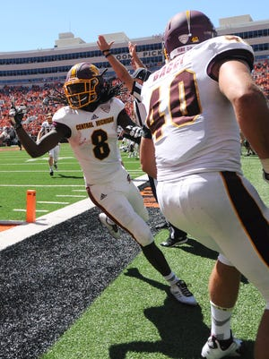 Central Michigan's Corey Willis (8) celebrates with teammate Joe Bacci after scoring the winning TD on the final play to beat against Oklahoma State, 30-27, in Stillwater, Okla., Saturday, Sept. 10, 2016.