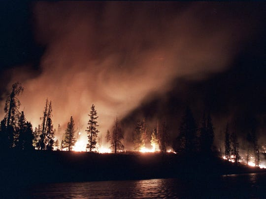 A forest fire blazes out of control near West Yellowstone
