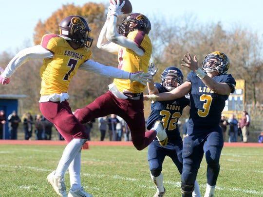 Gloucester Catholic's Dashaun Harris intercepts a pass