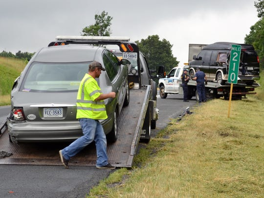 Towing companies work to remove vehicles on southbound Interstate 81  at mile marker 210 near Greenville.