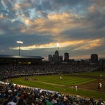 The sun sets over the Iowa Cubs home opener Friday, April 17, 2015.