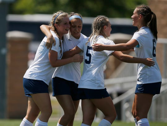 Players celebrate after Lewis Central freshman Grace