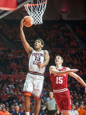 Illinois guard Mark Smith (13) goes up with a shot near Indiana guard Zach McRoberts (15) during the first half of an NCAA college basketball game in Champaign, Ill., Wednesday, Jan. 24, 2018. (AP Photo/Rick Danzl)