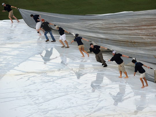The rain tarp comes off after a short rain delay before the Montgomery Biscuits vs. the Pensacola Blue Wahoos baseball game at Riverwalk Stadium in Montgomery, Ala. on Sunday June 8, 2014.