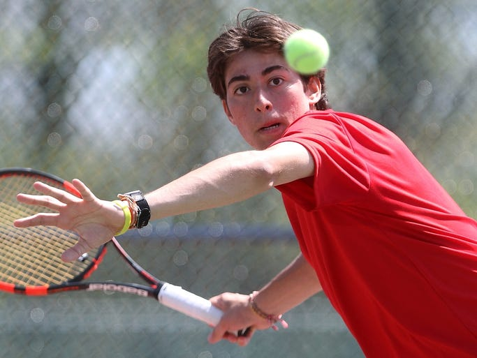 Gerard Giordano of Point Pleasant Beach returns a shot during his first singles semi-final match in the Ocean County boys tennis tournament, Sunday, May 11, 2014, in Toms River, NJ.  Jason Towlen/Staff Photographer