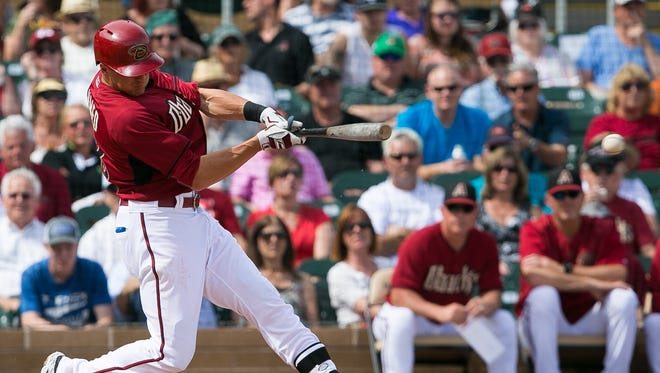 Arizona Diamondbacks infielder Nick Ahmed hits a double during their spring training game against the Los Angeles Angels at Salt River Fields at Talking Stick on Wednesday, March 11, 2015.