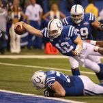 Colts quarterback Andrew Luck scores in the fourth quarter after recovering a fumble and diving into the end zone. The Indianapolis Colts hosted the Kansas City Chiefs at Lucas Oil Stadium Saturday, January 4, 2014.