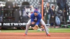 Cubs third baseman Kris Bryant takes ground balls during