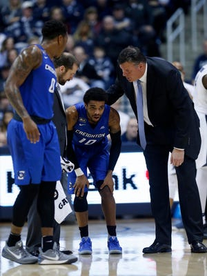 Creighton Bluejays head coach Greg McDermott (right) checks on guard Maurice Watson Jr. (10) during the first half against the Xavier Musketeers at the Cintas Center. Creighton won 72-67.