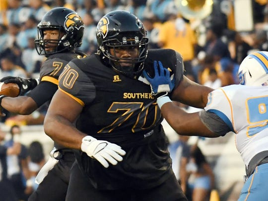 Southern Miss offensive lineman Jimmie Terry blocks